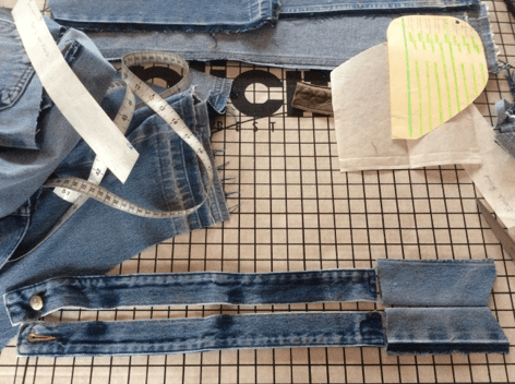 Taking apart denim jeans to show reuse of the waistband