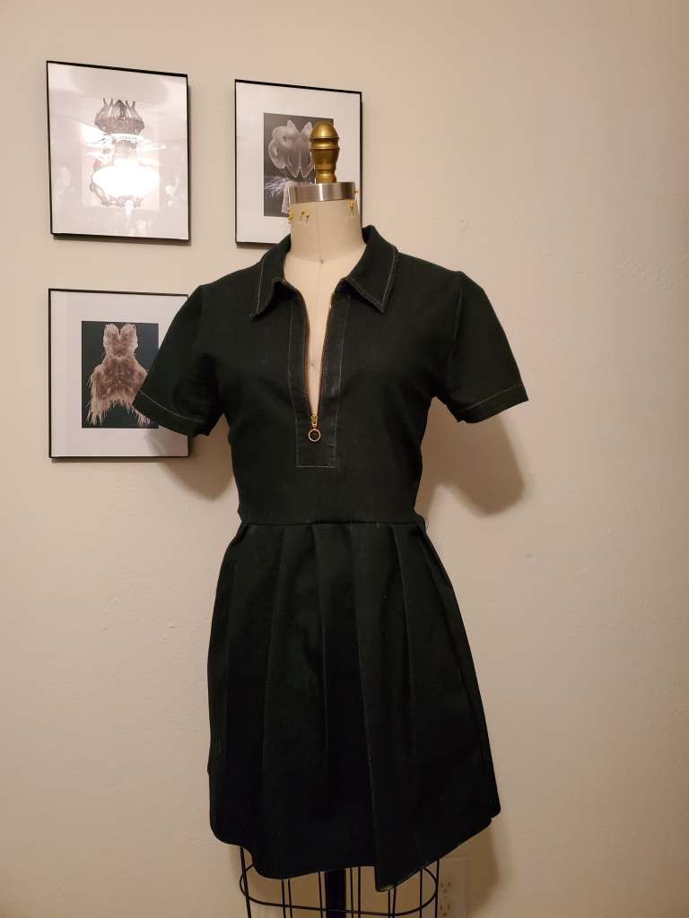 The tunic from above on a mannequin, altered to take in the bodice side seams, add a waist seam and pleat the skirt.