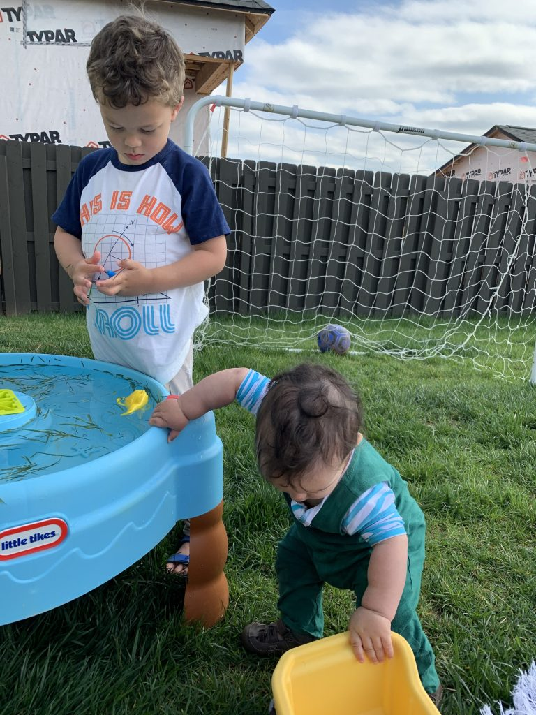 Amanda's kids play in their back yard at a water table.