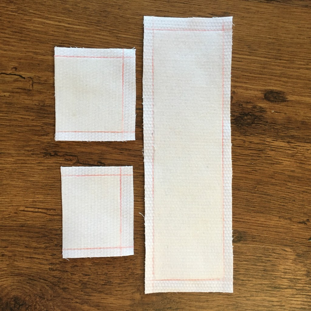 White fabric and interfacing with seam allowances marked in red