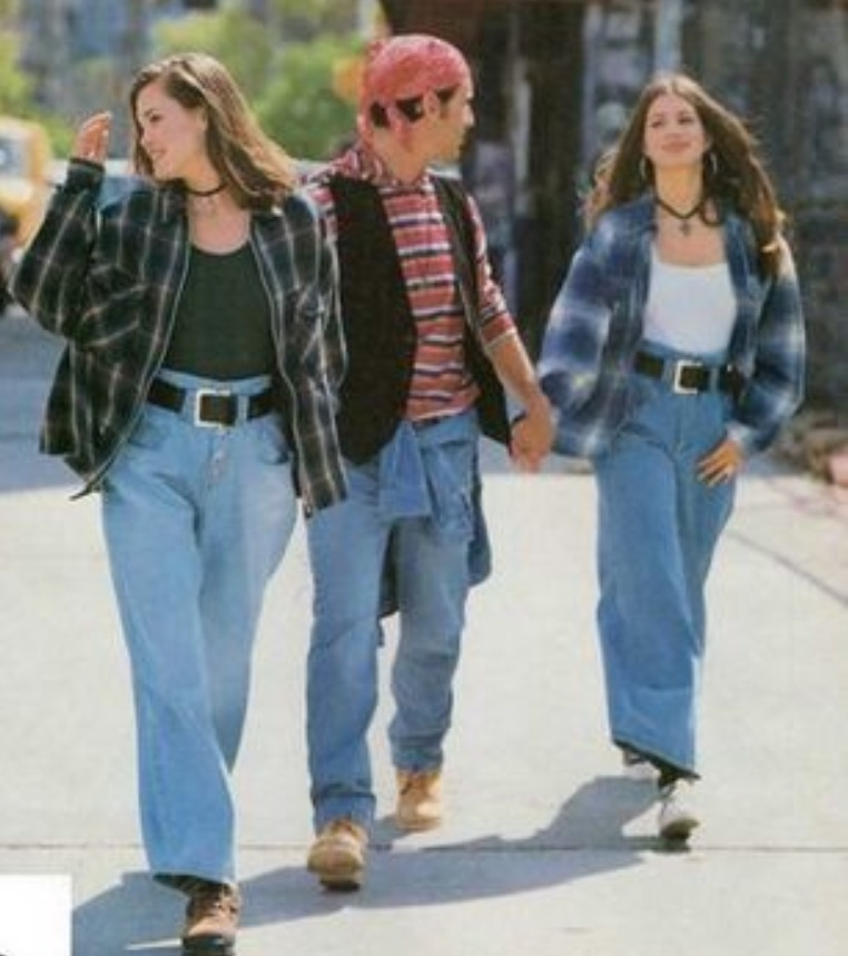 Three young people in jeans and layers of tops, none of which are cropped