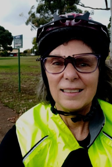 A picture of the author wearing a cycling helmet, cycling glasses and a high visibility jacket.