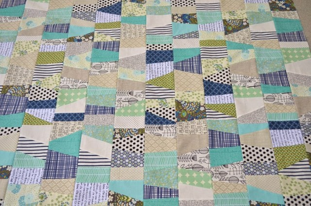 modern scrappy quilt navy and green by the sewing chick