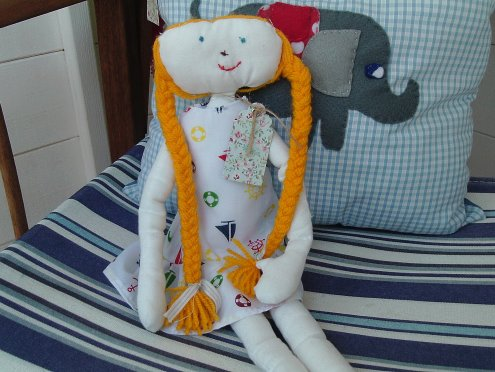 rag doll and elephant cushion