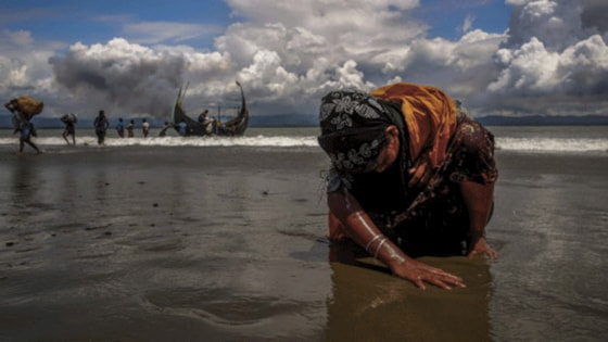 An exhausted Rohingya woman