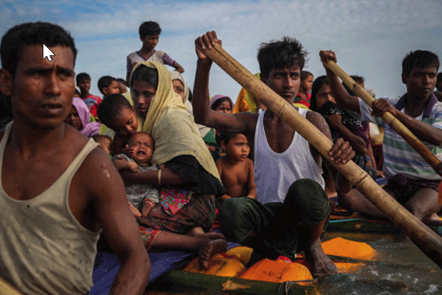 Rohingya refugees cross the Naf River with an improvised raft to reach to Bangladesh in Teknaf, Bangladesh (Part of Reuters series that won Pulitzer for feature photography)