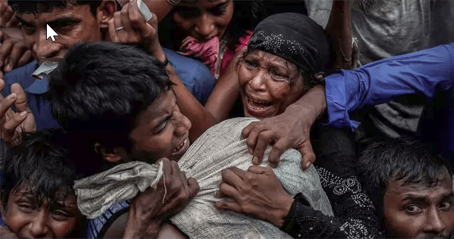 Rohingya refugees scramble for aid at a camp in Cox's Bazar, Bangladesh (Part of Reuters series that won Pulitzer for feature photography)