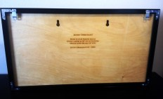 Back of the map, showing the mounting holes and a message to the family.