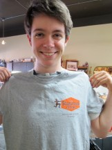 My son Parker showing off our new t-shirt.