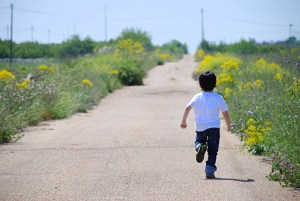 child running away from abuse
