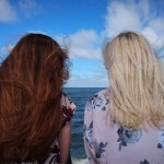 two women looking out at ocean having a discussion