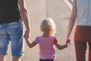 kid holding adults hands
