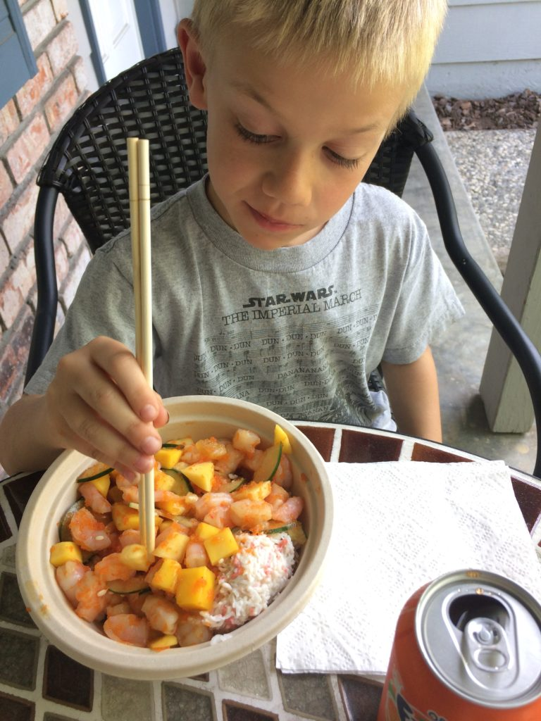 Landon and his to go poke bowl from the local place - shrimp, crab & mango madness