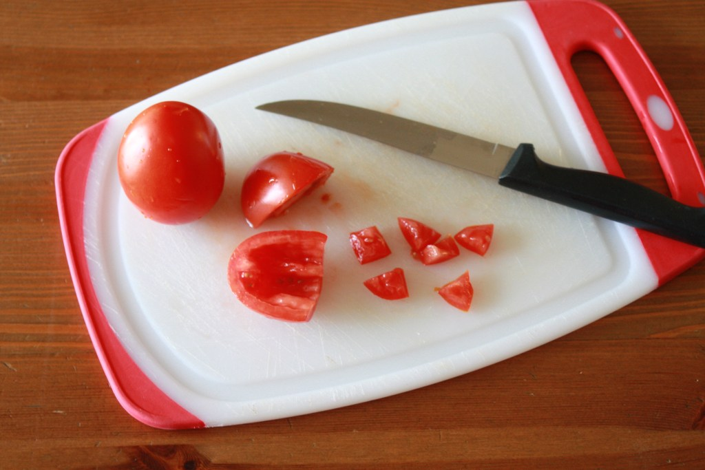 Small dice the roma tomatoes for the easy tomato basil bruschetta