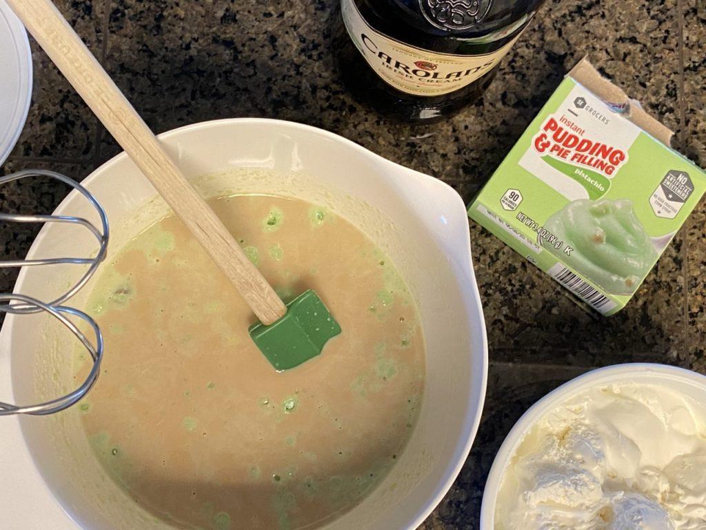 The Irish Cream will mute the green pudding color