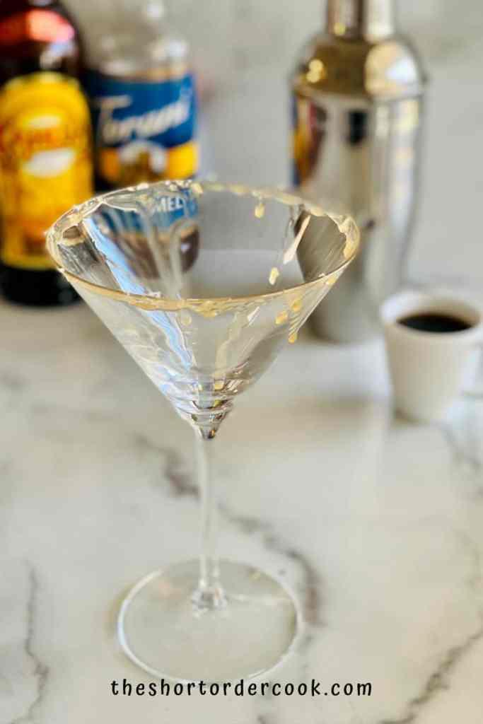 Salted Caramel Espresso Martini glass rim prepped with caramel and sea salt flakes