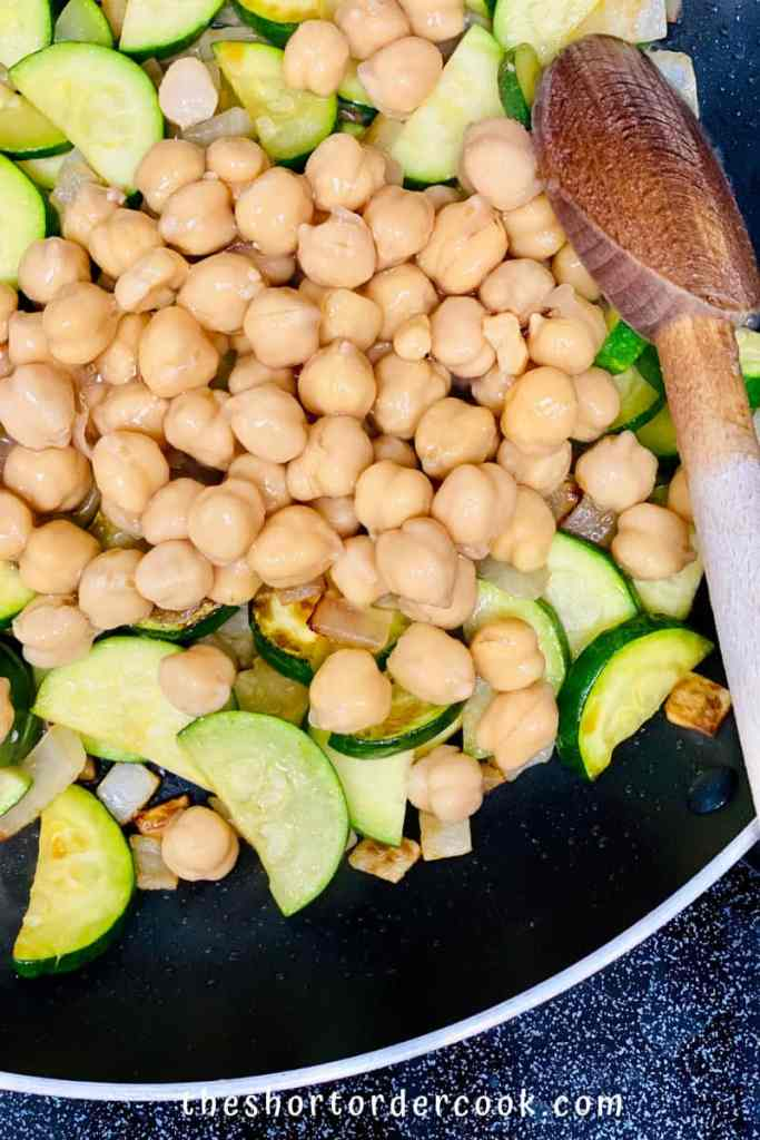Zucchini, Chickpea, & Potato Curry ingredients in the pan to saute
