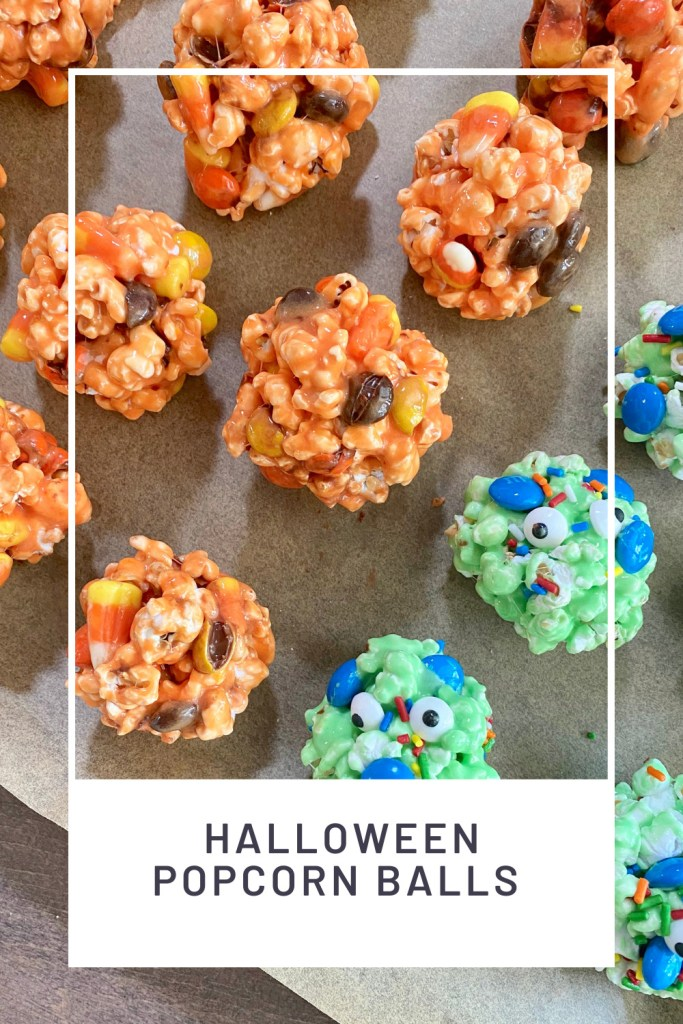 Halloween Popcorn Balls PINREDO a tray with orange popcorn balls and green monster popcorn balls