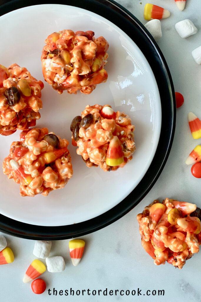 Halloween Popcorn Balls closeup of orange popcorn balls ready to eat