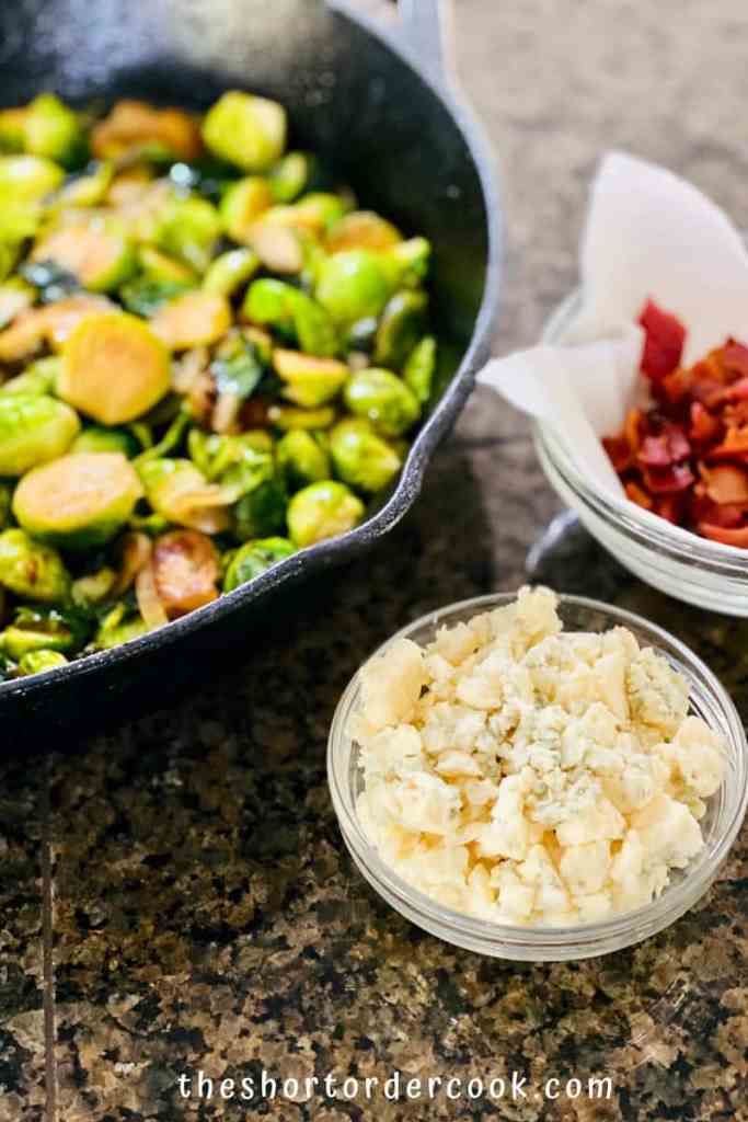 Caramelized Brussel Sprouts with Brown Sugar, Bacon, & Blue Cheese ready to eat with blue cheese and bacon in small bowls