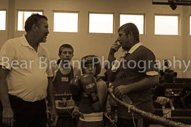 Gael Tavera waits in his corner with his coach, Damon Marceaux, of the Crowley Boxing Club.
