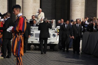And here comes the Pope Mobile!
