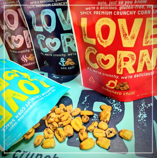 Four bags of Love, Corn gluten free snacks in smoked bbq, sea salt, habanero chilli and salt and vinegar flavour with corn nuts spilling out of one packet