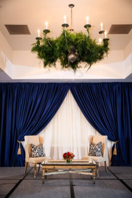 Stage setting was gorgeous. Furniture by Edge Floral Event Design and pipe and drape by Fabrication Events