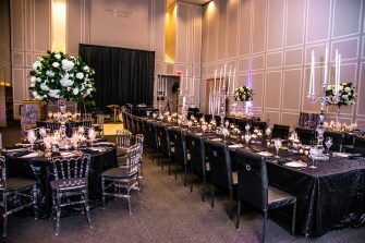 Black chairs sponsored by Tierra Floral Design.