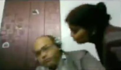 Screenshot from the video where woman tries to kiss her husband