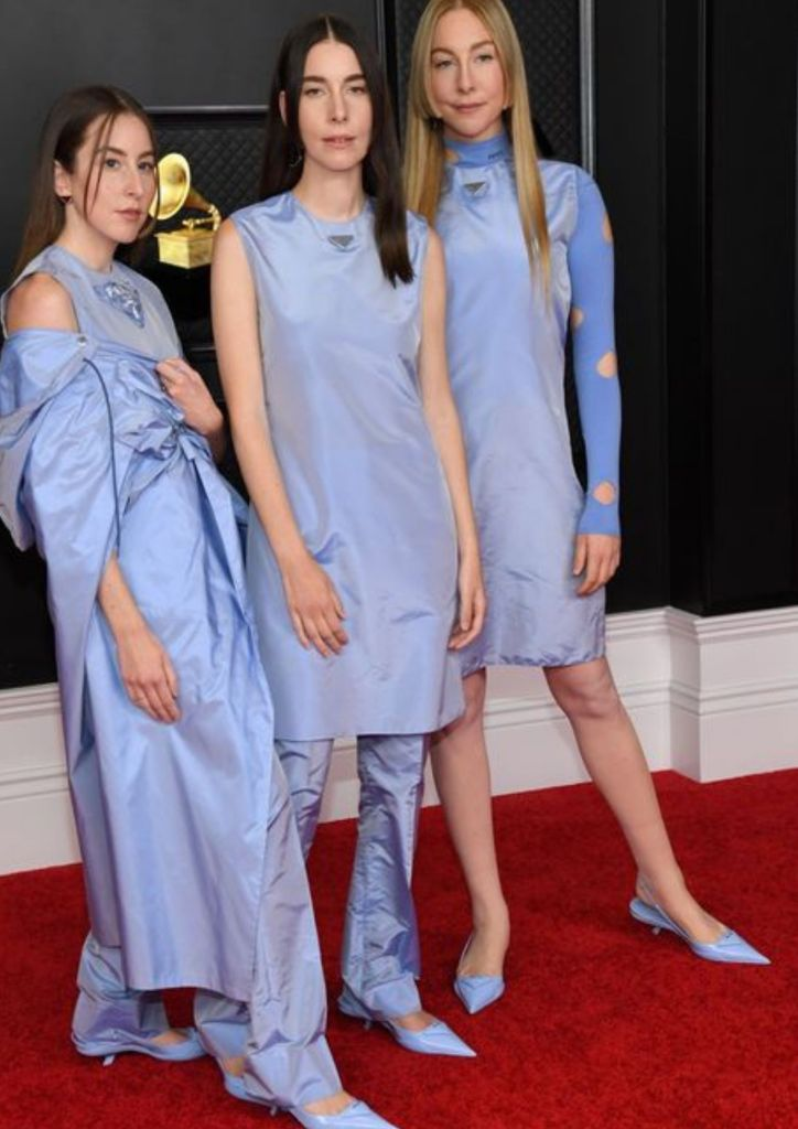 "Alana, Danielle and Este Haim looked beautiful in their matching lavender Prada outfits. They are nominated for their album ""Women in Music Pt. III."""