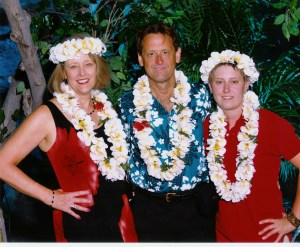 A great photo I found of my family at a luau in 2007. From left: Janis, my wife, me in the center and daughter, Angela on the right.