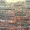 Bricks from original Cavern with Beatles, John, Paul, George, Ringo, Stu and Pete