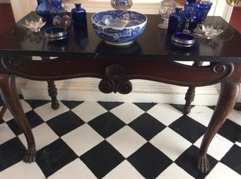 An Irish table stands of the tiled floor