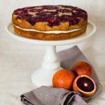 blood orange spice cake on white cake stand