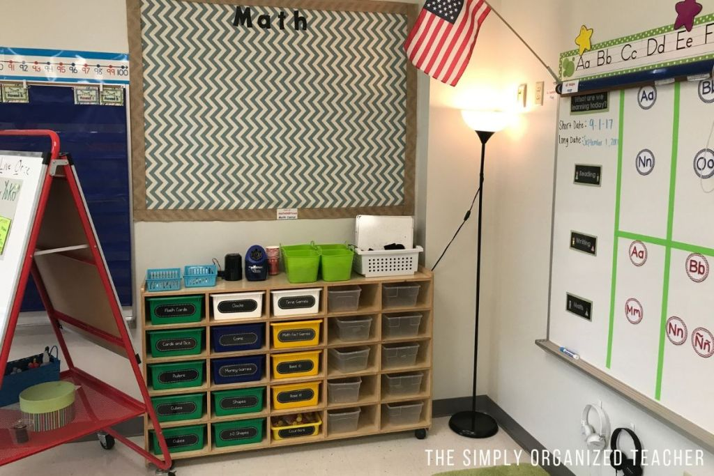 Math center storage area. Brown shelving unit with plastic boxes inside the shelf. The plastic boxes are labeled.