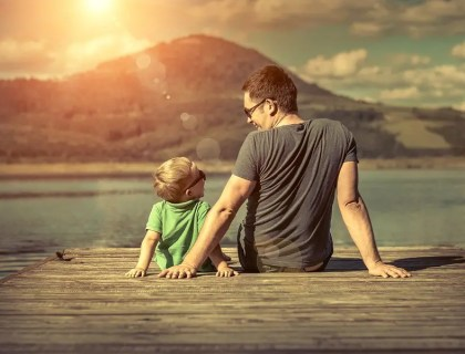 The Single Mom Blog - Happiness father and son on the pier at sunny day under sunlight