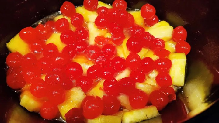 Preparing the Cherries and Pineapples in the Slow Cooker for the Cake