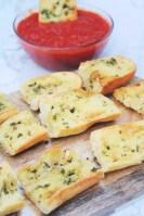 Serving Air Fryer Garlic Bread with Marinara Sauce