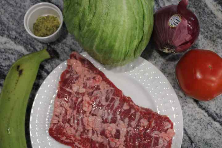 The ingredients used to make jibaritos are plantains, skirt steak, tomatoes, lettuce, onions, olive oil, adobo, Sazon and mayochup.