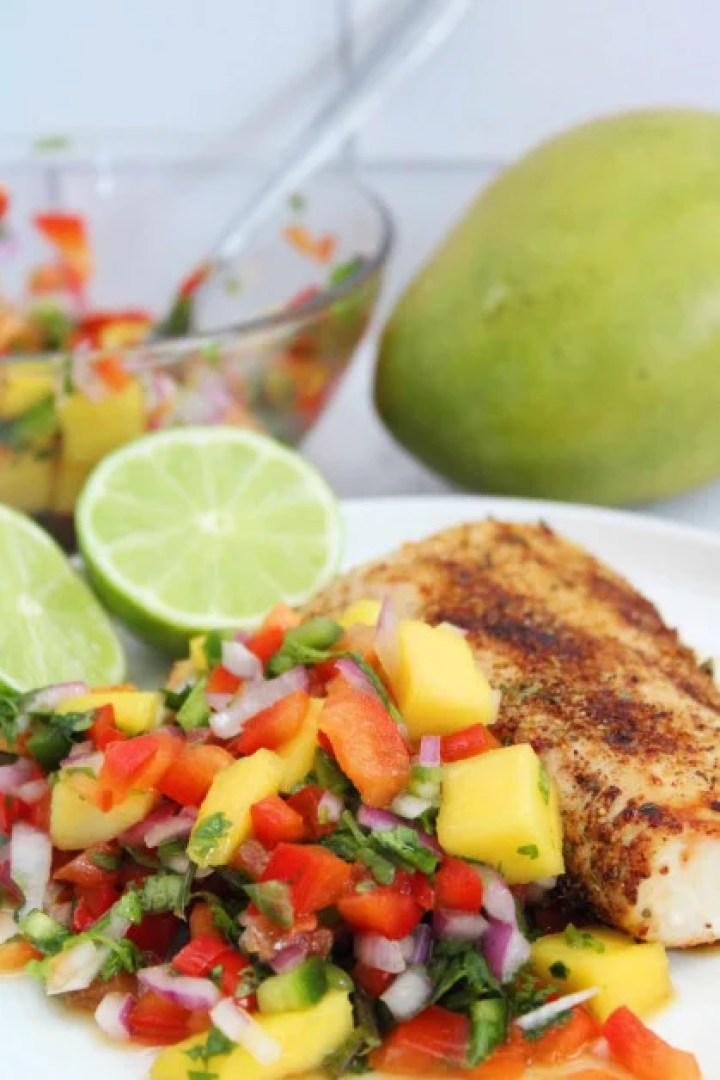 Homemade mango habanero salsa is served over air fryer Mahi Mahi fish.