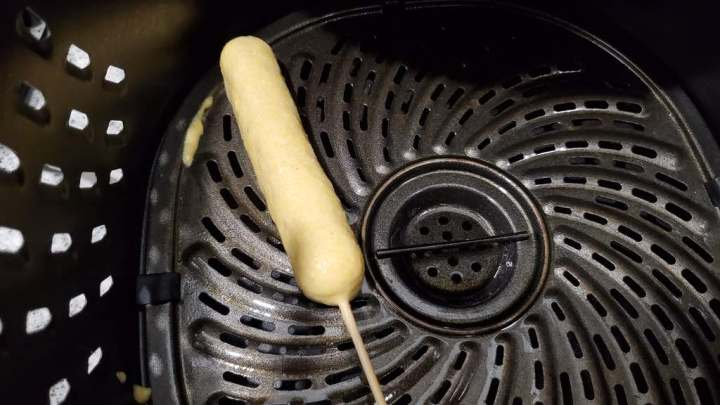 This is how you place the corn dog inside of the air fryer to make them.