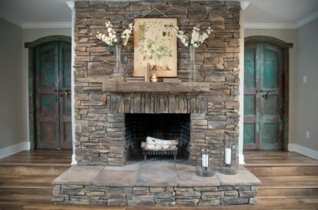 Get The Warmth of Charming Stacked Stone Fireplace Design in Your Living Room 5