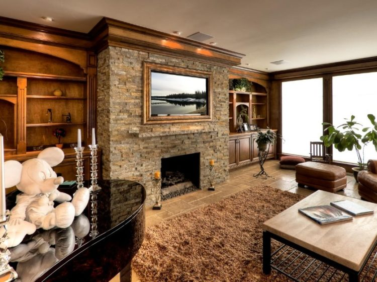 Get The Warmth of Charming Stacked Stone Fireplace Design in Your Living Room 1