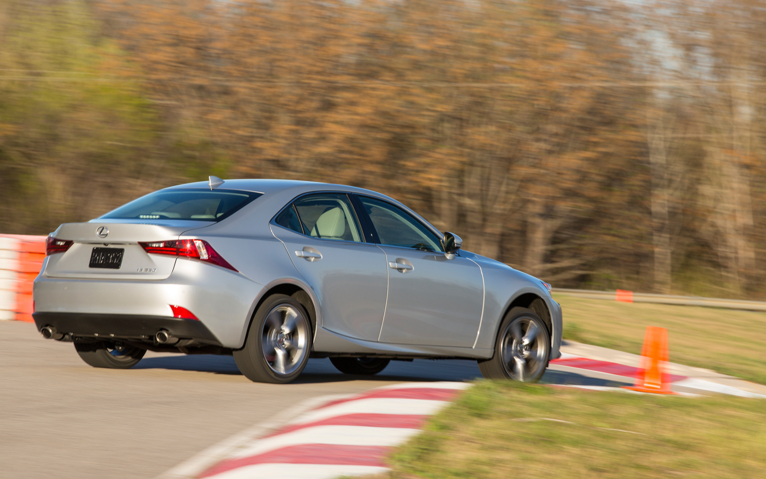 2014-Lexus-IS350-rear-three-quarter-on-track