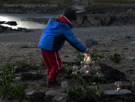 lighting candle on beach