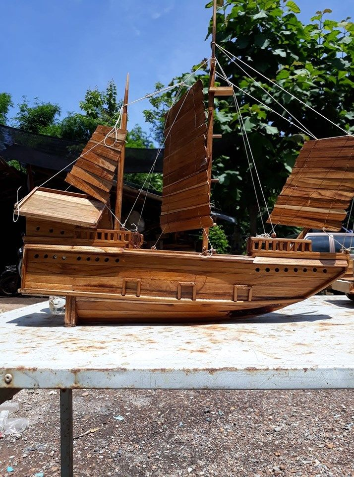 thai uncle make retro wooden boat toy