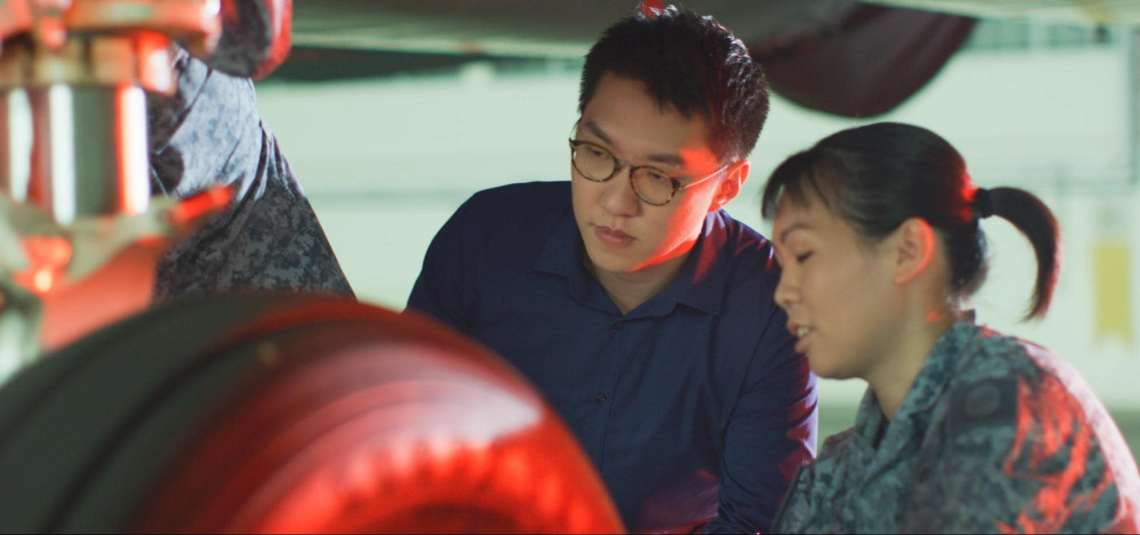 Chen Juncheng (left) from the Defence Science and Technology Agency (DSTA) helps the RSAF manage their aircrafts.