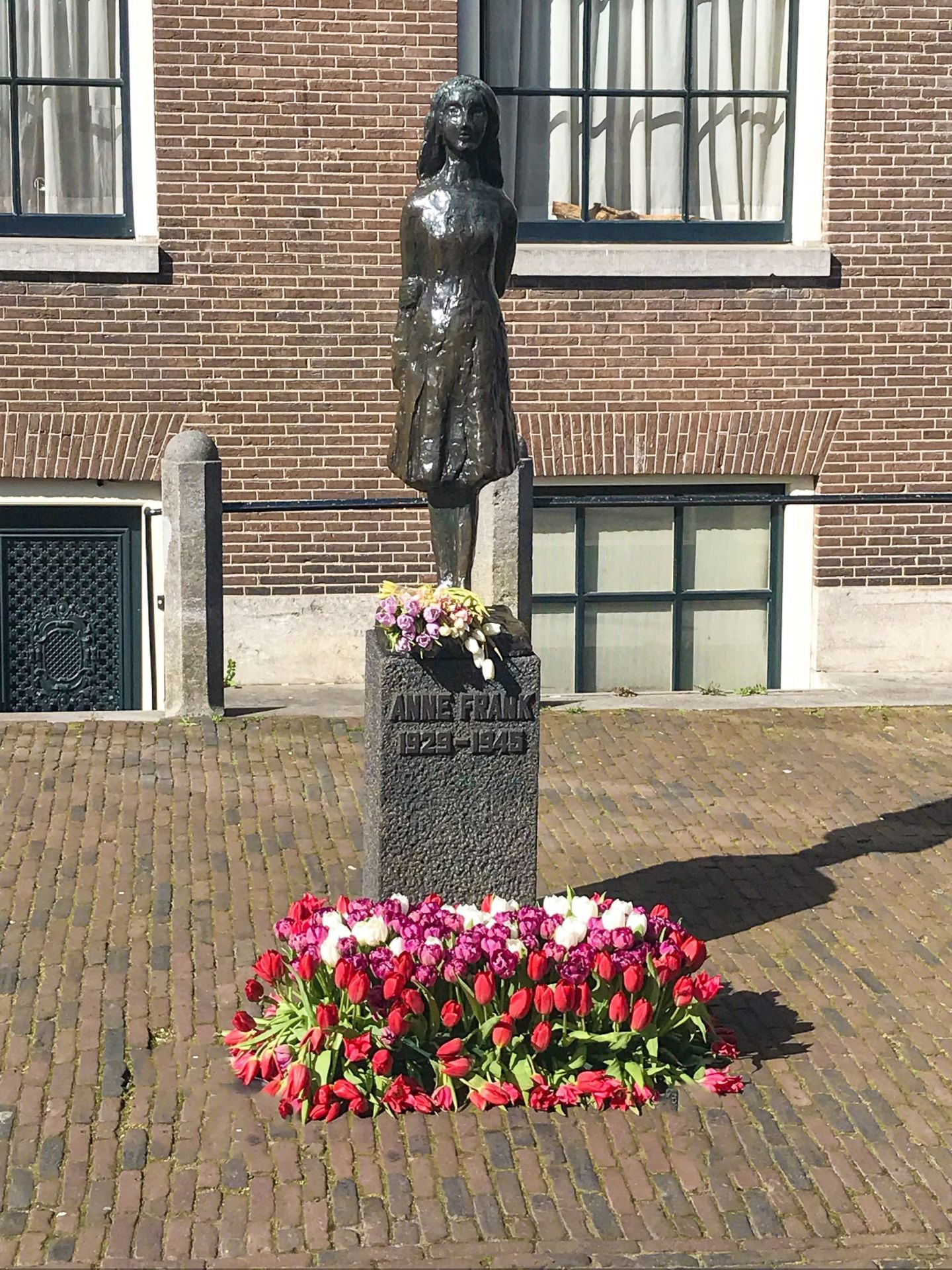 Memorial of Anne Frank outside Anne Frank Museum with fresh tulips