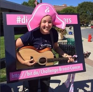 One of the fun educational stations at Breast-a-Ville was a singing station, where students could sing a song accompanied by a professional musician.